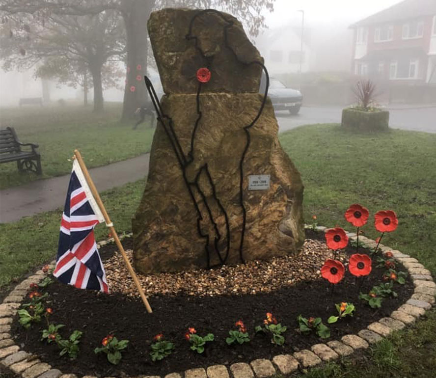 rememberance stone poppies union jack cloudy