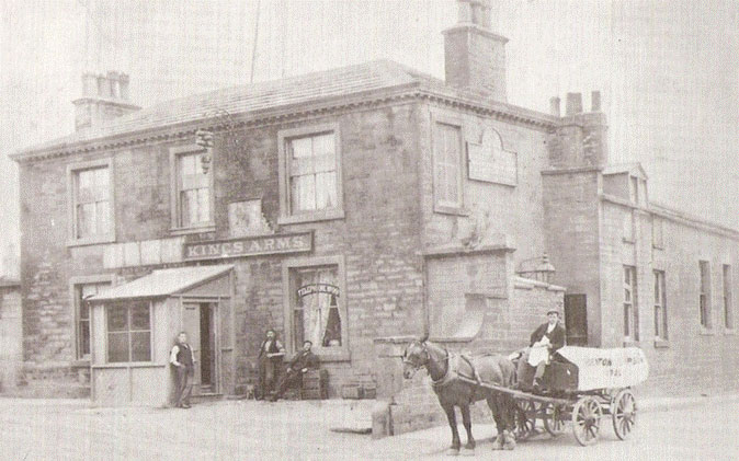 Black and white kings arms man horse and cart