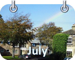 Sky rainbow trees house July