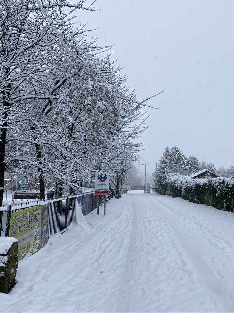 The drive way leading to Gildersome Primary School covered in snow